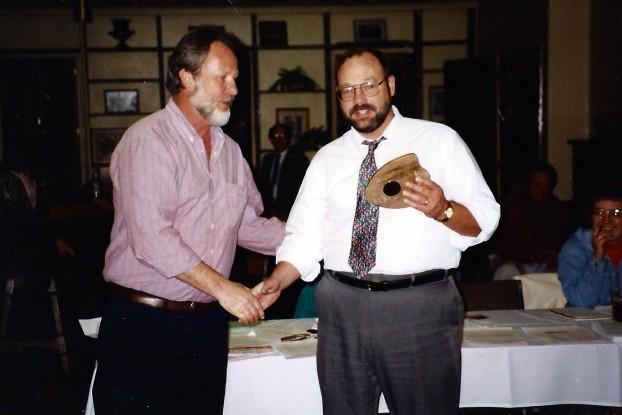 Jim Ludvik receives the Denver Newspaper Guild Volunteer Service Award from administrative officer Bruce Meachum.